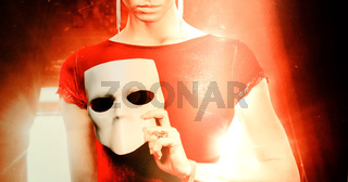 young woman holding mask.Fantasy mystic concept.