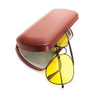 Anti-glare yellow glasses of driver and plastic case on white background