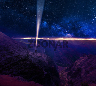 Two persons sending a light beam signal into outer space. Concept for astronomy, science and technology.