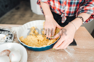 Housewife doing dough