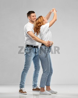 portrait of happy couple in white t-shirts dancing
