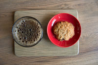 coffee and cookie on a wood board
