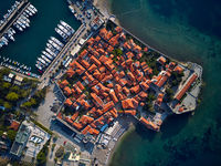 Old town and seashore with pier and beach in Budva in Montenegro