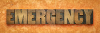 emergency word banner in wood type