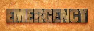 emergency word banner in wood type