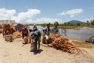 Malagasy woman on street sell firewood, Madagascar