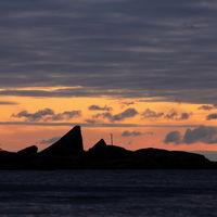 Bright morning sky and rock formation at Lake Vanern.