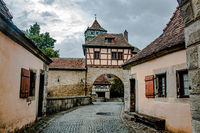 The stronghold gate in the medieval town Rothenburg ob der Tauber in a beautiful light , Germany.