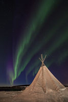 Drapery Aurora - Northern Lights dancing over a traditional sami tent