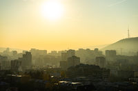 Misty autumnal sunrise over Tbilisi