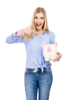 Woman pointing to a piggy bank