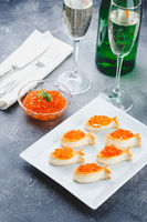 Delicious appetizer with red caviar.