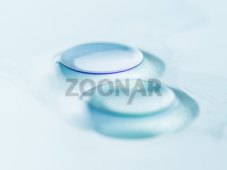Macro detail of modern rigid gas permeable contact lenses (GP) in storage solution