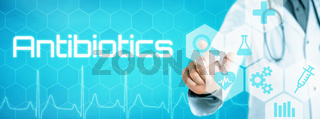 Doctor touching an icon on a futuristic interface - Antibiotics