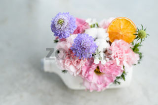 beautiful flowers and tree potted in white bottle pot