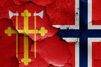 flags of Church of Norway and Norway painted on cracked wall