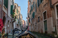 Panoramic view of Venice narrow canal with historical buildings from gondola