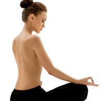 Topless woman meditating, isolated on white