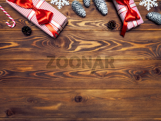 Pair of gift boxes on the wooden board