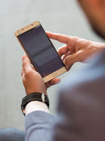 Close up of businessman using mobile smart phone.