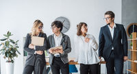 Business People standing in the office discuss