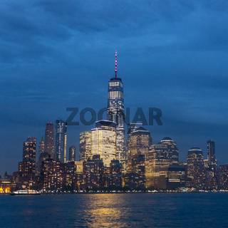 Panoramic view of Lower Manhattan from Ellis Island at dusk, New York City.