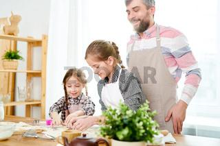 Loving Family Preparing Tasty Cookies