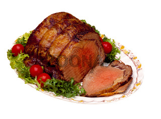Beef Roast sliced on platter with garnish, isolated on white