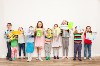Kids with their handmaded decorations or greeting card