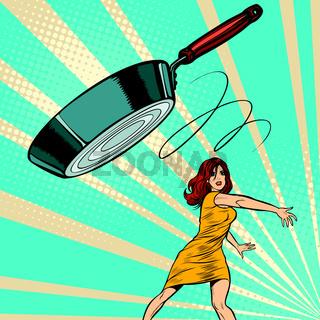 woman throws a frying pan