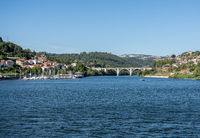 Boats and river cruise boat docked at Marina Entre os Rios on river Douro
