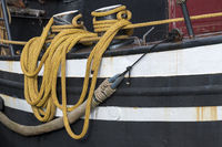 Yellow draped rope to a fishing boat