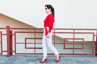 Young stylish woman in a red blouse