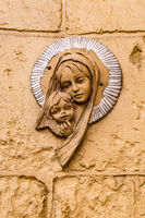 Virgin Mary icon. Religious icon on stone wall