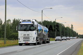 White Volvo Milk Tank Truck in Traffic