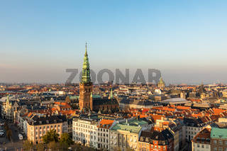 Copenhagen skyline in evening light. Copenhagen old town and copper spiel of Nikolaj Church.