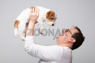 Adult man with terrier puppy