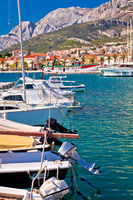 Colorful Makarska boats and waterfront under Biokovo mountain view