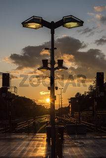 A single lamp at sunset in the city