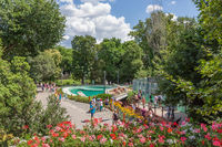 Budapest zoo with people at footpath surrounded with beautiful flowers