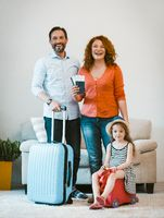 Family travel, happy couple and daughter setting off on journey.