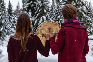 Couple is holding a native sacred drum