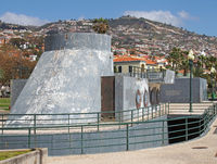 a grey shabby abandoned concrete building on the seafront in funchal madeira