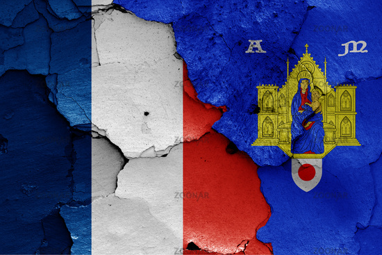 flags of France and Montpellier painted on cracked wall