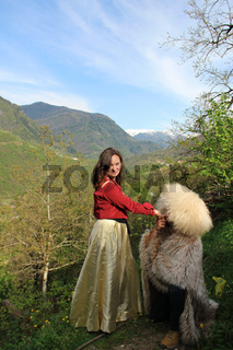 Photo of young brunette woman and a man in a traditional georgian costume