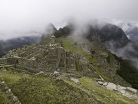 The Lost City Of The Incas On Machu Picchu. Low Clouds Covering Huayna Picchu, Peru