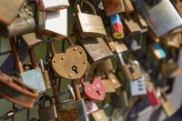 Lovelocks attached to a bridge of love railing in central Helsinki, Finland