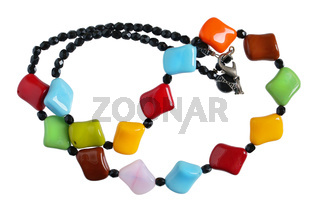 Homemade female beads are made of multi-colored smooth polished  stones and glass . Isolated