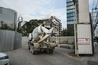 THAILAND, BANGKOK - January 20, 2019: Heavy concrete truck on construction site. Concrete mixing trucks on an industrial site.