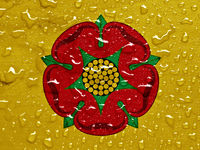flag of Lancashire with rain drops